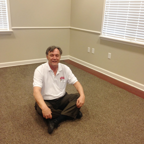 Man Sitting on New Carpet